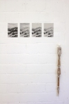 general view of installation 4 inktjet prints on silver paper, A5 format clay cast of inside mouth, found wooden stick