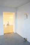 general view of site specific installation gold leaf, smashed tin cans, white spray paint, stone, approximately 45 cm x 45 cm