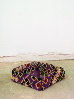 Muslim rug for praying, folded in-situ as an origami box