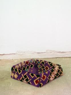 Muslim rug for praying, folded in-situ as an origami box