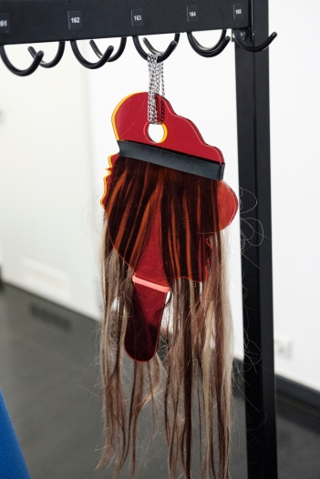 'Untitled', natural human hair, transparent plexiglass, rubber bands and metal chain, variable dimensions