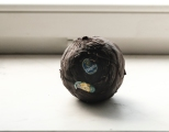'How things hold together, Warswa 2018', ball of 90 banana peels, daily consumption during residency period. Diameter 15 cm.